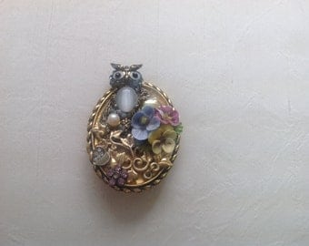 Gold tone owl broach with porcelain flower