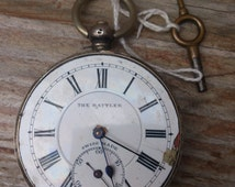 """Vintage Swiss Made """"The Rattler"""" sterling silver pocket watch with key, for repair"""