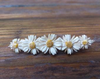 Vintage Daisy carved bone brooch