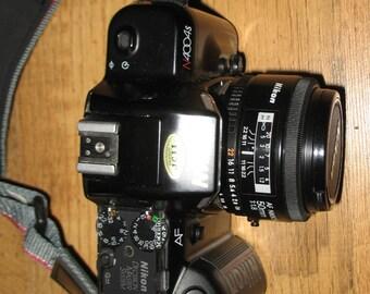 Nikon 4004S 35mm Film Camera, Nikor AF 50mm lens, Padded, adjustable compartment camera bag, 3 rolls of 800 sp 24 exposure film