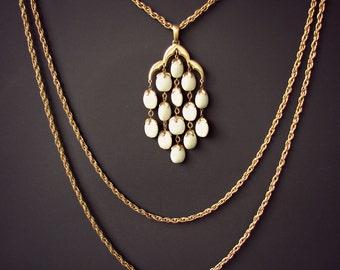 Lucite jewelry . TRIFARI waterfall multi strand necklace. Off white  Lucite bold pendant.