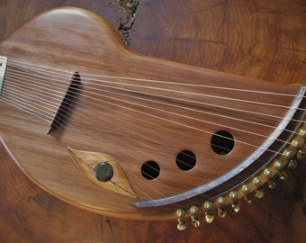 Handmade musical string instrument.Harp like sound. 15 note. Guitar tuners. Easy to play and travel with.