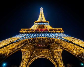 The Eiffel Tower at night, in Paris, France. | Photo Print, Stretched Canvas, or Metal Print.