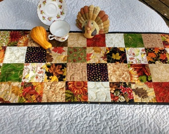 Quilted Fall Table Runner, Scrappy Autumn Table Topper.  Fall Fabrics. Reversible to Winter/Christmas. 14 plus x 38.5 inches. Great gift.