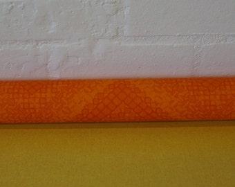 Roll of vintage orange wallpaper