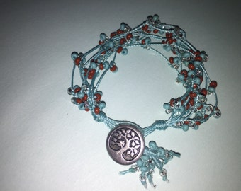 Turquoise waxed beaded 8 string bracelet with button