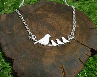 Silver plated bird family necklace
