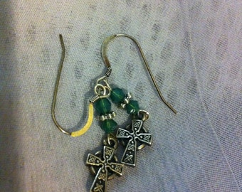 Green Swarovski and silver pierced earrings with Celtic cross charms.