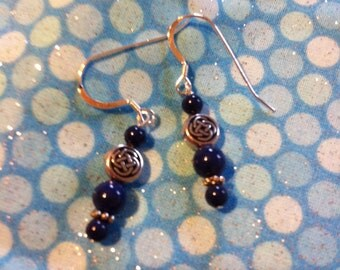 Blue and silver pierced earrings with Celtic knot beads.
