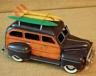 Vintage reproduction metal woody station wagon with surfboards, vintage toy car, vintage metal truck, vintage toy beach stationwagon