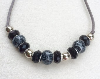 Silver & black patterned necklace
