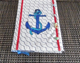 notebook with a blue anchor