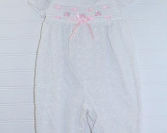Vintage baby romper, white eylet with smocking and pink satin detailing, no name sz 6-9 mo