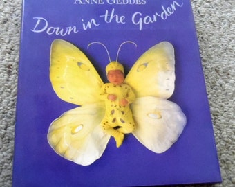 Down in the Garden.  A lovely hard back book (with dust cover), by Anne Geddes.  6th printing, 1996, baby art, garden art, Geddes babies