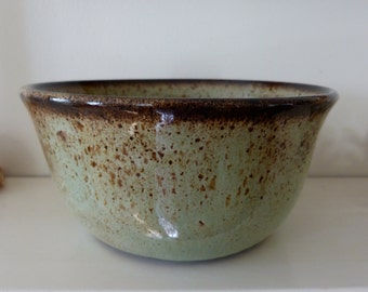 Green and brown speckled cereal bowl.