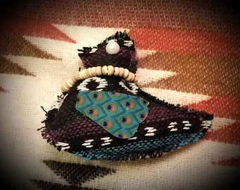 Hand-crafted totem bird blessed with white sage