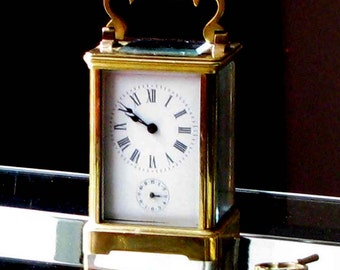 Clock officer travel in nineteenth century gilded bronze