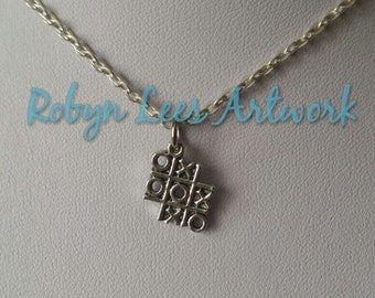 Small Silver Noughts & Crosses Tic Tac Toe Grid Game Charm Necklace on Silver Crossed Chain