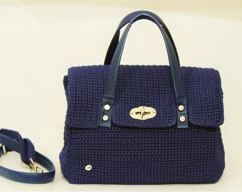 Lanyard and blue leather handbag
