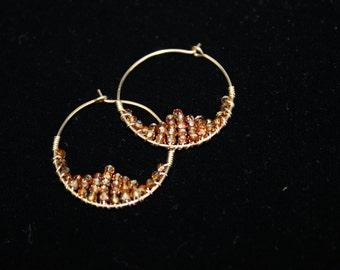 Swarovski copper colored woven hoop earrings