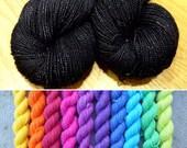 Black Sparkle Rainbow Mini Skein Gift Set, ten bright colours merino nylon sock yarn plus a full 100g sparkly black