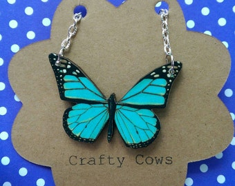 Beautiful blue and black butterfly necklace - small wooden butterfly necklace nature festival butterfly jewellery
