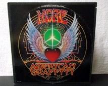 More American Graffiti - Original Motion Picture Soundtrack. 2 LP's. 1979 vinyl LP 33 record set. My Boyfriends Back, Hang On Sloopy...