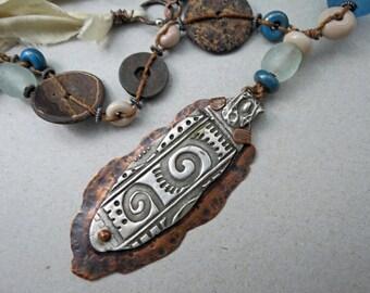 Silver metal clay pendant over copper