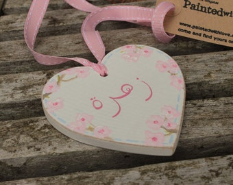 Personalised Arabic new baby girl hand-painted wooden heart