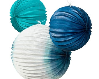 3 x Coastal Paper Lanterns each with a different design and color.