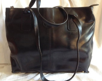 Vintage black leather, wearing elbow or shoulder, unbranded bag.