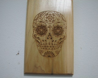 Day of the dead skull wood carving.