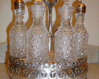 Victorian silver plated and crystal Tantalus cruet set circa 1890