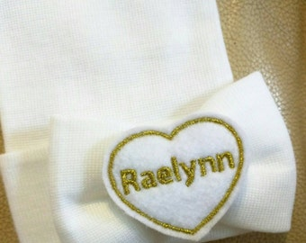 Exclusive White Newborn Hospital Hat Monogrammed. PERSONALIZED! Bow with Name in Glitter Gold on Heart! 1st Keepsake!