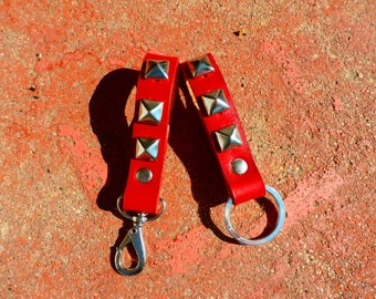 Handmade leather keychain in red with pyramid studs