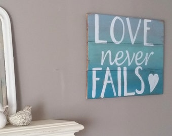 "Reclaimed wood sign ""Love never fails"" super sweet in a nursery or as a wedding /anniversary gift"