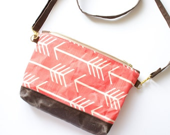 Waxed Canvas cross body bag with coral arrow print