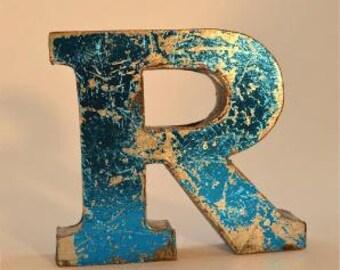 A fantastic vintage style metal 3D blue letter R