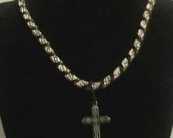Silver and flat black twisted cross pendant necklace