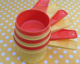 Set of 6 Tupperware measuring cups in yellow and orange, 1970s