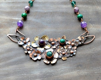 Purple and turquoise flowers, copper necklace, amethyst and lava