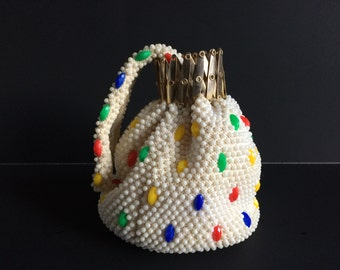 Vintage gold tone accordion gate top white and multi-color beaded wristlet pouch