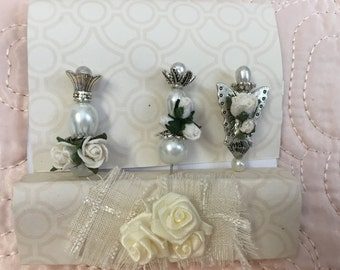 Decorative stick pins. With paper roses