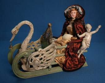 1/12th scale figure of a woman in a sleigh