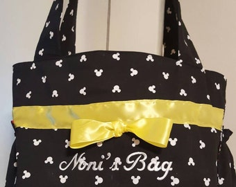 This cute Mickey diaper bag was made for a grandma to use. The side pockets can hold a water bottle as well as a sippy cup.