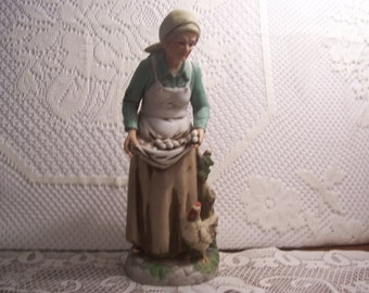 Old Woman with a Chicken and Eggs Figurine