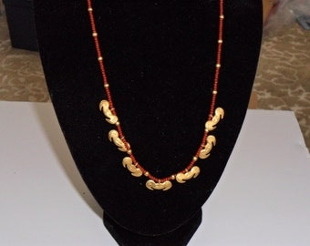 Coral and Gold-Colored Beaded Ethnic Looking Necklace!