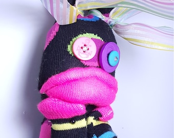 Gloria the pouty lipped, striped and polka dotted sock monster!