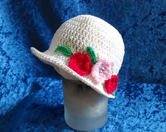 Darling white floral embellished infant crocheted hat