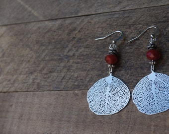Elegant earrings with silver pendants and matching beads